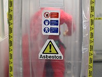 Asbestos enclosure airlock with operative inside