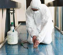 Operative wetting asbestos materials before removal, taken from HSE website